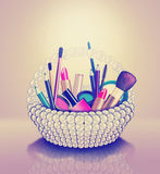 Cosmetics set into a pearl basket Stock Image
