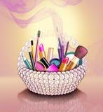 Cosmetics set into a pearl basket Stock Photos