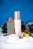 Cosmetics set on snow. Stock Photo