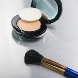 Cosmetics on silver background Stock Photos