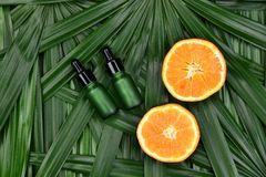Cosmetics skincare with vitamin-c extract, Cosmetic dropper bottle containers with fresh orange slices. Cosmetics skincare with vitamin-c extract, Cosmetic royalty free stock image