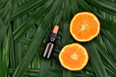 Cosmetics skincare with vitamin-c extract, Cosmetic dropper bottle containers with fresh orange slices. Cosmetics skincare with vitamin-c extract, Cosmetic stock photos