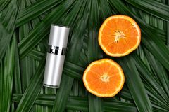 Cosmetics skincare with vitamin-c extract, Cosmetic dropper bottle containers with fresh orange slices. Cosmetics skincare with vitamin-c extract, Cosmetic royalty free stock images