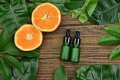 Cosmetics skincare with vitamin-c extract, Cosmetic dropper bottle containers with fresh orange slices. Cosmetics skincare with vitamin-c extract, Cosmetic stock image