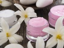 Natural cosmetics, fresh as spring flowers. With cosmetics on the table with decoration, beauty concept stock images