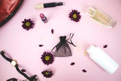 Cosmetics on the table at the woman. Cosmetic bag, cosmetic and hygiene products. Pink background for text royalty free stock photo