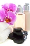 Cosmetics and towels with pink orchid. Stock Photo