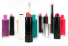 Cosmetics. Various cosmetic products in front of white background royalty free stock photo