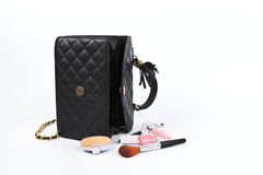Cosmetics in women bag. Royalty Free Stock Images