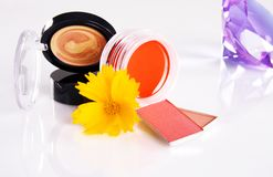 Cosmetics with a yellow flower and violet crystal Stock Image