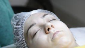 Cosmetologist applying permanent makeup on eyebrow-eyebrow tattoo stock video