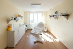Cosmetologist cabinet with massage table in modern beauty salon. Medical cabinet interior. Small modern beauty parlor.  royalty free stock photos