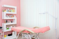 Cosmetologist cabinet with massage table in modern beauty saloon. Medical cabinet interior. stock photo