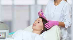 Free Cosmetologist Does Prp Therapy Against Hair Loss Of A Beautiful Woman In A Beauty Salon. Treatment Of Problem Skin Cosmetology Stock Photos - 168513543