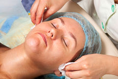 Cosmetologist doing facial massage Stock Photography