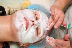 Cosmetologist doing facial massage Royalty Free Stock Photography