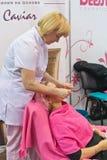Cosmetologist doing facial massage Royalty Free Stock Photos