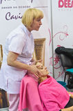 Cosmetologist doing facial massage Royalty Free Stock Photo