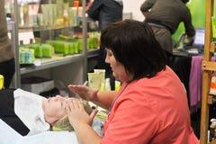 Cosmetologist doing facial massage Stock Photos