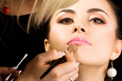 Cosmetologist Doing Make-up Stock Photos