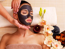 Cosmetologist doing massage on the woman's face in sap salon royalty free stock photos