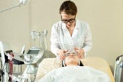 Cosmetologist Performing Face Massage Fotografía de archivo