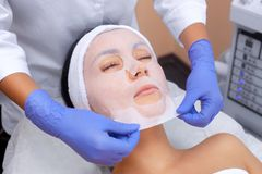 The cosmetologist for procedure of cleansing and moisturizing the skin Stock Image