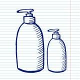 Cosmetology μπουκάλια στο υπόβαθρο copybook Στοκ Εικόνα