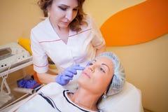 Cosmetology advice women before treatment Royalty Free Stock Photos