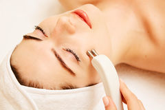Cosmetology. Beautiful Woman At Spa Clinic Receiving Stimulating Electric Facial Treatment From Therapist. Closeup Of Stock Photos
