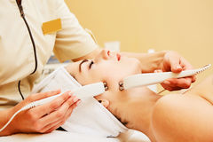 Cosmetology. Beautiful Woman At Spa Clinic Receiving Stimulating Electric Facial Treatment From Therapist. Closeup Of. Young Female Face During Microcurrent Royalty Free Stock Photography