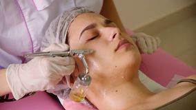 cosmetology beauty clinic.Professional cosmetologist conducts cell oxygenation for the face Ozone treatment with