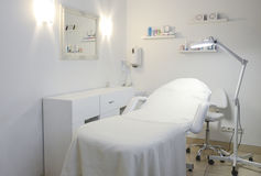 Cosmetology clinic. Modern cosmetology clinic room with dominatting white colour royalty free stock photos