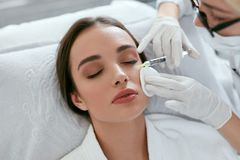 Cosmetology Procedure. Woman Receiving Face Skin Lift Injections. Around Eyes. High Resolution stock images