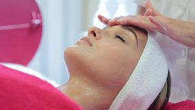 Cosmetology procedures. Facial cleansing stock footage