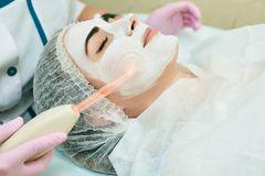 Cosmetology room, treatment and skin cleansing with hardware, acne treatment stock photography
