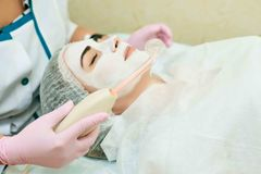 Cosmetology room, treatment and skin cleansing with hardware, acne treatment royalty free stock photography