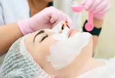 Cosmetology room, treatment and skin cleansing with hardware, acne treatment stock photos
