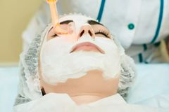 Cosmetology room, treatment and skin cleansing with hardware, acne treatment stock photo