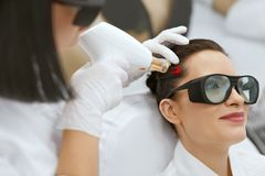 Cosmetology. Woman At Hair Growth Laser Stimulation Treatment Royalty Free Stock Image