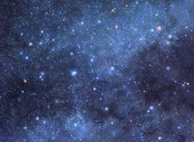 Cosmic background. Colorful night sky filled with myriads of bright stars Royalty Free Stock Photo