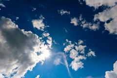Cosmic blue sky and bright sun Royalty Free Stock Photo