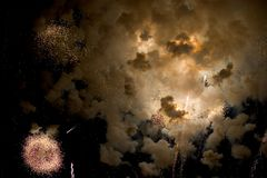 Cosmic Boom. Sparks, fire and smoke fill the black sky royalty free stock image