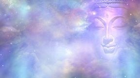 Cosmic Buddha Vision Cloud scape. Semi transparent Buddha face with closed eyes amongst the celestial heavens providing a beautiful pink and blue sky background royalty free stock photography