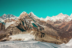 Cosmic coloured View of high Altitude Mountains in Himalaya Stock Photos