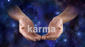 Cosmic Karma is in Your Hands Stock Photography