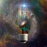 Cosmic light bulb Royalty Free Stock Image