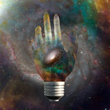 Cosmic light bulb with stars Stock Photo