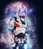 Cosmic Soldier. The cosmic warrior is transported down to the hostile planets surface. Weapons holstered but ready for action Royalty Free Stock Photo