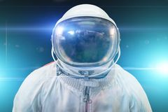Cosmonaut or astronaut or spaceman suit and helmet with blue light effects. Close up royalty free stock photo